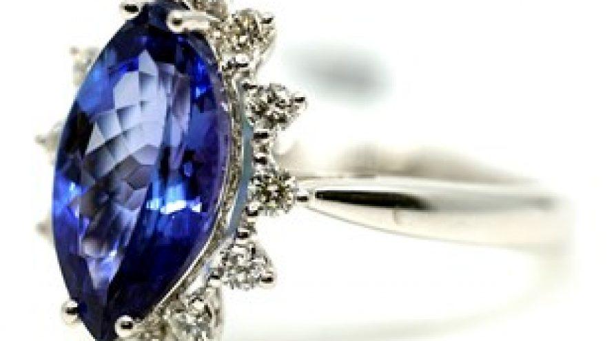 18K WHITE GOLD TANZANITE AND HALO DIAMOND RING