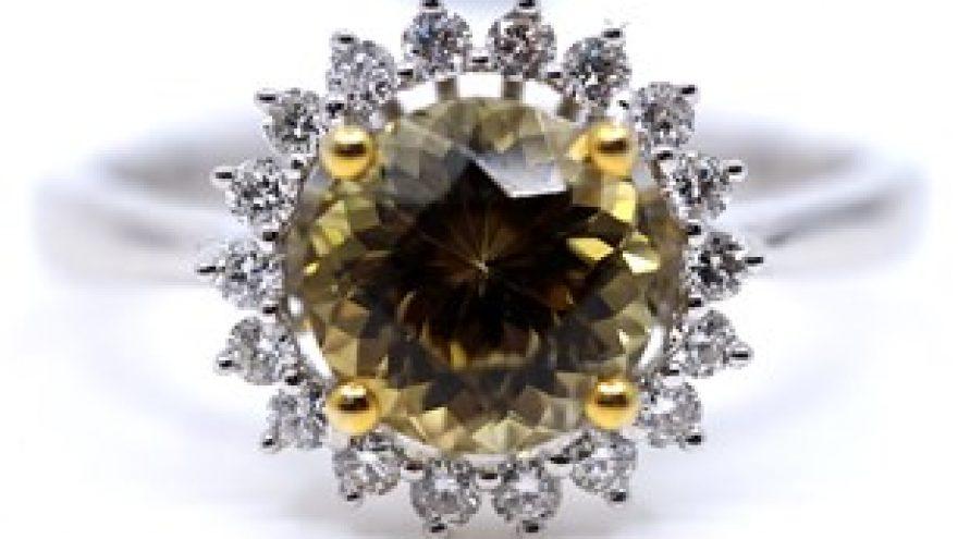 18K WHITE GOLD UNHEATED YELLOW TANZANITE AND HALO DIAMOND RING