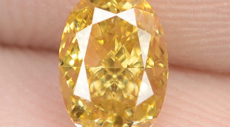 0.53 Carat Natural Fancy Vivid Yellow – Orage Color Diamond VS1