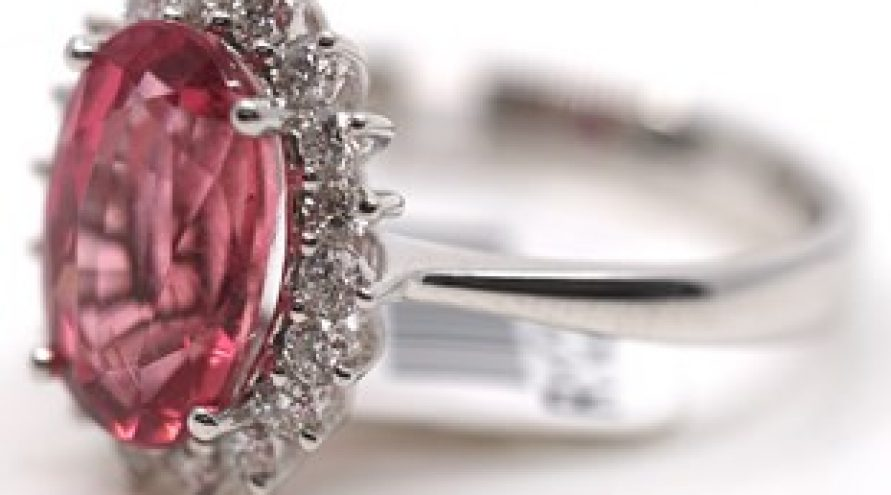 18 K WHITE GOLD RUBELITE AND HALO DIAMOND RING