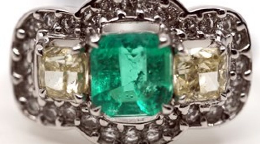 COLOMBIA EMERALD AND DIAMOND THREE STONE CUSHION RING