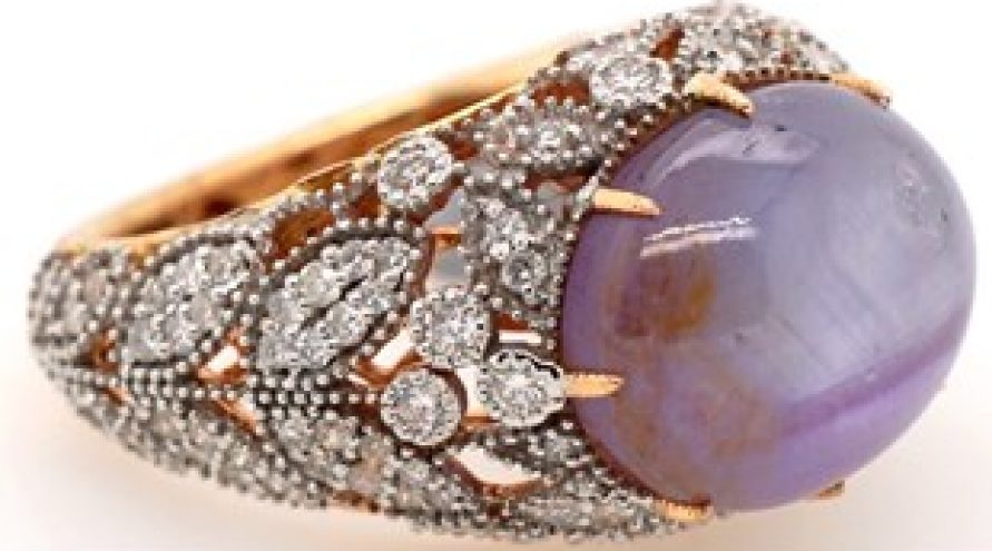 18 K CARAT DIAMOND AND STAR SAPPHIRE RING