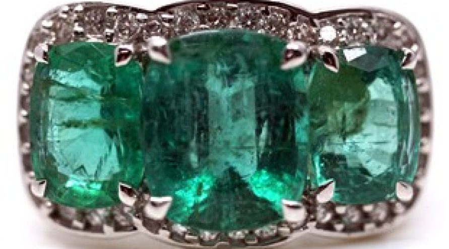 18K WHITE GOLD EMERALD AND DIAMOND THREE STONE CUSHION RING